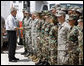 President George W. Bush meets military personnel Monday, Sept. 1, 2008 at the Alamo Regional Command Reception Center at Lackland Air Force Base in San Antonio, Texas, after attending a briefing on the response preparation for Hurricane Gustav. White House photo by Eric Draper