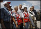 President George W. Bush stands with a group of Red Cross volunteers as he talks with reporters Monday, Sept. 1, 2008 at the Alamo Regional Command Reception Center at Lackland Air Force Base in San Antonio, Texas, where the President participated in a briefing on the response preparation for Hurricane Gustav. Texas Senator Kay Bailey Hutchison and FEMA Administrator David Paulison are seen at right. White House photo by Eric Draper