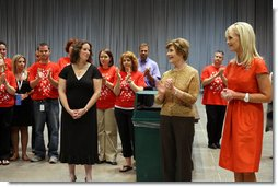 Mrs. Laura Bush and Mrs. Cindy McCain applaud the efforts of volunteers who are setting up a space in Minneapolis Convention Center Monday, September 1, 2008, to assemble and ship out care kits to support the victims of Hurricane Gustav.  White House photo by Shealah Craighead