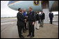 President George W. Bush is greeted by Baton Rouge Mayor Kip Holden after arriving in Louisiana Wednesday, Sept. 3, 2008. The President met with federal, state and local officials at the Louisiana State Emergency Operations Center for a briefing in the aftermath of Hurricane Gustav. White House photo by Eric Draper