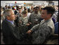 "President George W. Bush greets military personnel who assisted with Hurricane Gustav emergency response during his briefing Wednesday, Sept. 3, 2008, at the Louisiana State Emergency Operations Center in Baton Rouge. Acknowledging the response and coordination efforts, the President said, ""State government, the local government and the federal government were able to work effectively together."" White House photo by Eric Draper"