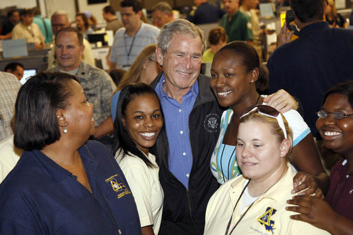 "President George W. Bush stands with workers inside the Louisiana State Emergency Operations Center Wednesday, Sept. 3, 2008, in Baton Rouge. Speaking to all those who came to the aide in the wake of Hurricane Gustav, the President said, ""I want to thank all the volunteers and the faith-based community that always rises up in a challenge like this. They listen to that universal call to love a neighbor. And that's happening here in Louisiana again."" White House photo by Eric Draper"
