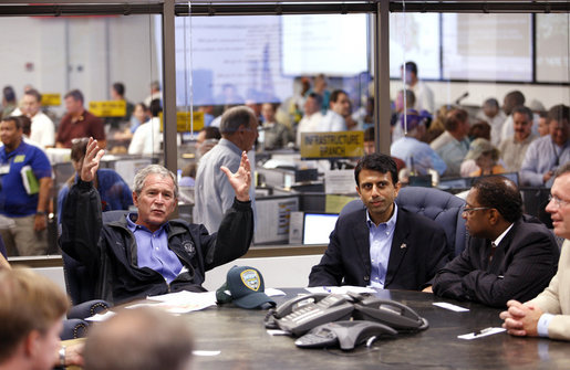 President George W. Bush speaks with federal, state and local officials at the Louisiana Emergency Operations Center in Baton Rouge, Wednesday, Sept. 3, 2008, where he was briefed in the aftermath of Hurricane Gustav. Gustav was a Category 2 storm when it made landfall Monday, in Cocodrie, La. At the request of Gov. Bobby Jindal, center, President Bush Tuesday issued a Major Disaster Declaration for 34 of the state's parishes. Baton Rouge Mayor Kip Holden listens at right. White House photo by Eric Draper