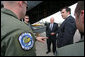 Members of the 37th Airlift Squadron, the Blue Tail Flies, talk with Vice President Dick Cheney and Georgian President Mikheil Saakashvili Thursday, Sept. 4, 2008 during the leaders' visit to a U.S. a relief operation center at Tbilisi International Airport, Georgia. White House photo by David Bohrer