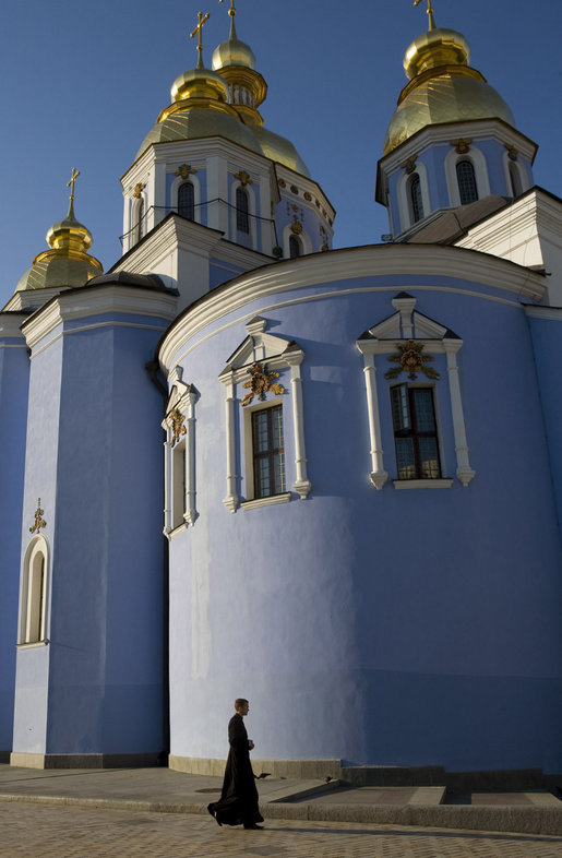 A member of the clergy walks past the gold-domed St. Michael's Monastery in the early morning light of Friday, Sept. 5, 2008 in Kyiv, where Vice President Dick Cheney is currently visiting during a multi-day tour of ex-Soviet republics. The monastery, originally constructed in the 12th century, is named after the Archangel Michael, patron saint of Kyiv, and was destroyed by Soviet communists between 1934-36 and reconstructed in 2000. White House photo by David Bohrer