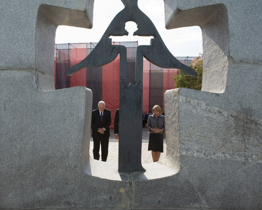 Seen through the Holodomor Memorial, Vice President Dick Cheney observes a moment of silence Friday, Sept. 5, 2008 in Kyiv, to remember the millions of Ukrainians murdered between 1932-33 during a Soviet enforced artificial famine. Mrs. Kateryna Yushchenko, wife of Ukrainian President Yushchenko, is at right. White House photo by David Bohrer