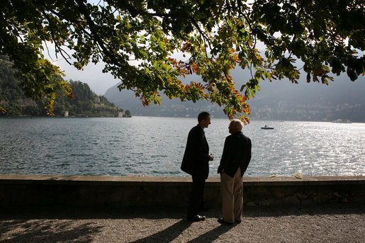 Vice President Dick Cheney speaks with an advisor Saturday, Sept. 6, 2008, between meetings at the Ambrosetti Forum on the shoreline of Lago di Como in Cernobbio, Italy. Following his visit to Lago di Como, the Vice President will travel to Rome to meet with Italian officials on the final leg of an international trip to Europe and Central Asia. White House photo by David Bohrer