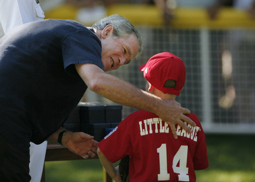President George W. Bush presents a game ball to Stripes player Adam Plante, 6, of Burke, Va., following the Tee Ball on the South Lawn: A Salute to the Troops game Sunday, Sept. 7, 2008, played by the children of active-duty military personnel. White House photo by Andrew Hreha