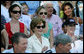 Mrs. Laura Bush is joined by her daughters, Barbara, background-left, and Jenna, background-right, as they watch action at the Tee Ball on the South Lawn: A Salute to the Troops game Sunday, Sept. 7, 2008 at the White House, played by the children of active-duty military personnel. White House photo by Joyce N. Boghosian