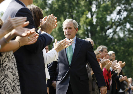 President George W. Bush is applauded following his remarks highlighting the achievements of volunteerism and work of the USA Freedom Corps Monday, Sept. 8, 2008, on the South Lawn of the White House. White House photo by Eric Draper