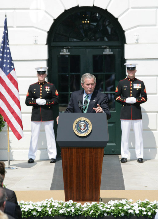President George W. Bush gestures as he addresses his remarks highlighting the achievements of the USA Freedom Corps and honoring volunteerism Monday, Sept. 8, 2008, on the South Lawn of the White House. White House photo by Eric Draper