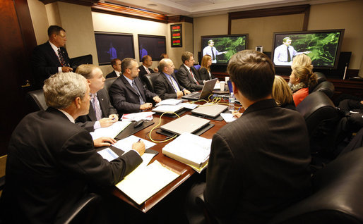 President George W. Bush is briefed on Hurricane Ike Thursday, Sept. 11, 2008, in the Situation Room of the White House. The massive storm is predicted to make landfall within the next 48 hours. White House photo by Eric Draper