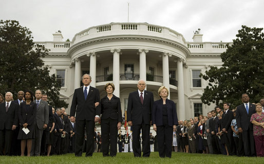 President George W. Bush and Mrs. Laura Bush and Vice President Dick Cheney and Mrs. Lynne Cheney stand at attention during the observance Thursday, Sept. 11, 2008, on the South Lawn of the White House of the seventh anniversary of the September 11 terrorist attacks. White House photo by Eric Draper