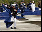 A Marine removes a ceremonial cloth during the unveiling of 184 memorial benches at the 9/11 Pentagon Memorial Thursday, Sept. 11, 2008, in Arlington, Va. White House photo by Eric Draper