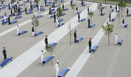 Military personnel stand at attention behind each of the 184 memorial benches draped in ceremonial cloths Thursday, Sept. 11, 2008, during the dedication of the 9/11 Pentagon Memorial at the Pentagon in Arlington, Va. White House photo by Chris Greenberg