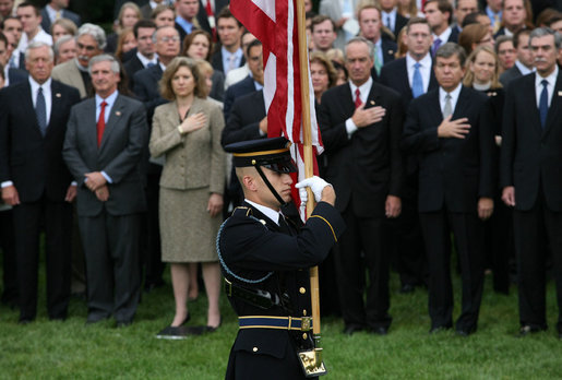 An honor guard presents the American Flag on the South Lawn of the White House Thursday, Sept. 11, 2008, during an observance of the seventh anniversary of the September 11 terrorist attacks. White House photo by Joyce N. Boghosian