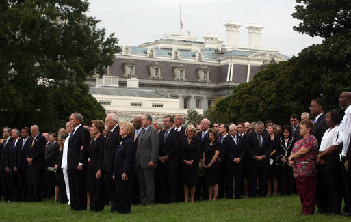President George W. Bush and Mrs. Laura Bush stand with Vice President Dick Cheney and Mrs. Lynne Cheney and staff, family and friends Thursday, Sept. 11, 2008, in a South Lawn observance of the seventh anniversary of the September 11 terrorist attacks. White House photo by David Bohrer