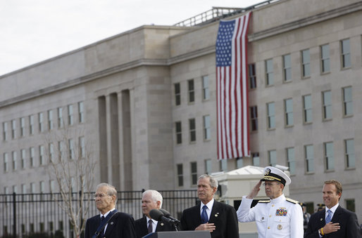 President George W. Bush is joined from left by former Secretary of Defense Donald Rumsfeld, U.S. Secretary of Defense Robert Gates, Chairman of the Joint Chiefs of Staff, Admiral Michael Mullen and James J. Laychak, chairman of the Pentagon Memorial Fund, Inc.,Thursday, Sept. 11, 2008, during National Anthem at the dedication of the 9/11 Pentagon Memorial at the Pentagon in Arlington, Va. White House photo by Eric Draper