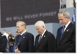 President George W. Bush is joined by former Secretary of Defense Donald Rumsfeld, left, and U.S. Secretary of Defense Robert Gates, as they bow their heads during a moment of silence Thursday, Sept. 11, 2008, during the dedication of the 9/11 Pentagon Memorial at the Pentagon in Arlington, Va. White House photo by Eric Draper