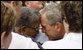 President George W.B ush embraces a family member during the Pentagon Memorial dedication ceremony Thursday, Sept. 11, 2008 at the Pentagon in Arlington, Va., where 184 memorial benches were unveiled honoring all innocent life lost when American Airlines Flight 77 crashed into the Pentagon on Sept. 11, 2001. White House photo by Eric Draper
