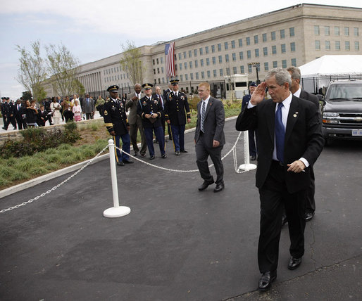President George W. Bush salutes to military personnel as he arrives at the Pentagon Thursday, Sept. 11, 2008, for the dedication of the 9/11 Pentagon Memorial at the Pentagon in Arlington, Va. White House photo by Eric Draper