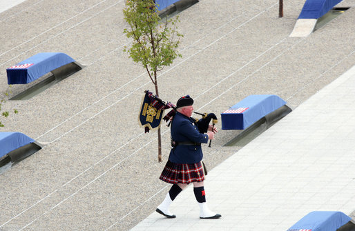 A bagpiper plays as he walks through the 9/11 Pentagon Memorial Thursday, Sept. 11, 2008, during the dedication ceremony of the 9/11 Pentagon Memorial at the Pentagon in Arlington, Va. White House photo by Chris Greenberg