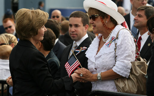 Mrs. Laura Bush speaks with a family member attending the Pentagon Memorial dedication ceremony Thursday, Sept. 11, 2008 at the Pentagon in Arlington, Va., where 184 memorial benches were unveiled honoring all innocent life lost when American Airlines Flight 77 crashed into the Pentagon on Sept. 11, 2001. White House photo by Joyce N. Boghosian