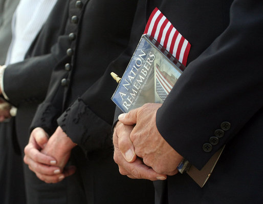Vice President Dick Cheney is seen holding a flag and a commemorative program during the dedication ceremony of the 9/11 Pentagon Memorial Thursday, Sept. 11, 2008, at the Pentagon in Arlington, Va. White House photo by David Bohrer