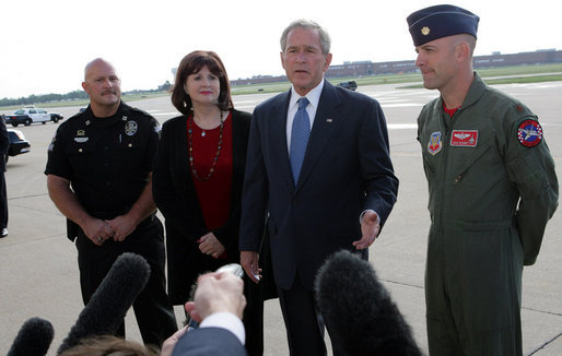 "President George W. Bush speaks to the media upon his arrival Friday, Sept. 12, 2008, at Tinker Air Force Base, Oklahoma. Speaking about the impending landfall of Hurricane Ike, the President said, ""I want to thank the citizens of Oklahoma for getting ready to help a Texan in need. I urge my fellow Texans to listen carefully to what the authorities are saying in Galveston County or parts of Harris County, up and down the coast. The federal government will not only help with the pre-storm strategy, but once this storm passes we'll be working with state and local authorities to help people recover as quickly as possible."" White House photo by Chris Greenberg"
