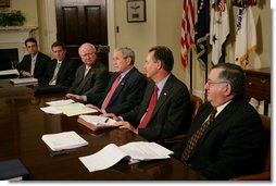 President George W. Bush is joined by Secretary of Energy Samuel Bodman, (third from left), FEMA Administrator David Paulison, (second from right), and Deputy Secretary for the Department of Homeland Security Paul Schneider, right, as he speaks to the press from the Roosevelt Room following a briefing on the latest developments concerning Hurricane Ike, Sunday, Sept. 14, 2008. White House photo by Chris Greenberg