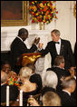 President George W. Bush and President John Agyekum Kufuor of Ghana tip their glasses in a toast during a White House State Dinner Monday, Sept. 15, 2008, in honor of President Kufuor and Mrs. Theresa Kufuor. White House photo by Eric Draper