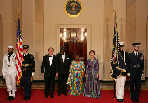 President George W. Bush and Mrs. Laura Bush pose with President John Agyekum Kufuor of Ghana and Mrs. Theresa Kufuor after their arrival at the White House Monday, Sept. 15, 2008, for a State Dinner. White House photo by Chris Greenberg
