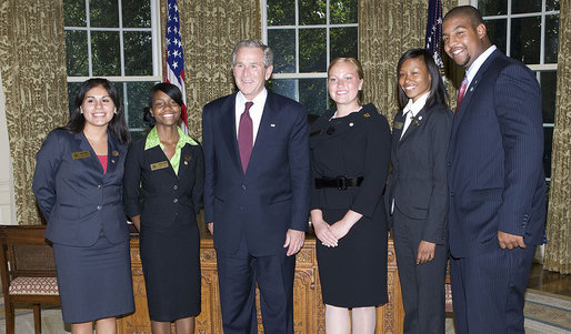 President George W. Bush stands with the 2008 Boys and Girls Clubs of America Regional Finalists for Youth of the Year Monday, Sept. 15, 2008, in the Oval Office of the White House. From left are: Felicia Arriaga, of Hendersonville, N.C.; Shonnetta Henry, of Denver; President Bush; Ashley Turner, of Portland. Ore.; Naquasia Pinchback, of Glen Cove, N.Y., and Jamaal Phillips, of St. Louis. White House photo by Chris Greenberg