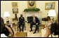 President George W. Bush and President John Agyekum Kufuor of Ghana pause for photos in the Oval Office prior to their meeting Monday, Sept. 15, 2008, at the White House. White House photo by Eric Draper