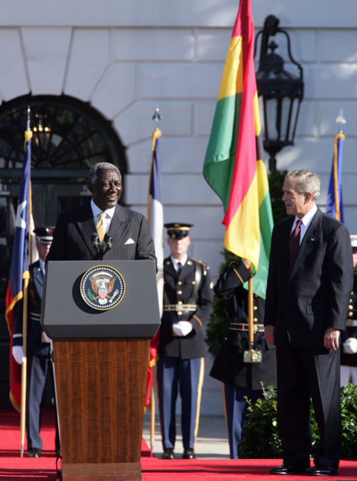 President George W. Bush smiles as President John Agyekum Kufuor of Ghana delivers remarks Monday, Sept. 15, 2008, during the South Lawn Arrival Ceremony for President Kufuor and Mrs. Theresa Kufuor of Ghana on the South Lawn of the White House. White House photo by Chris Greenberg