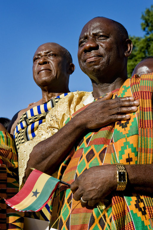 Guests in traditional Ghanaian dress stand for the playing of the national anthems Monday, Sept. 15, 2008, during the South Lawn Arrival Ceremony for President John Agyekum Kufuor of Ghana at the White House. White House photo by David Bohrer