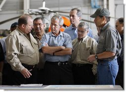 "President George W. Bush meets with locals officials at the U.S. Coast Guard facility at Ellington Field in Houston Tuesday, Sept. 16, 2008 before taking an aerial tour of Texas areas damaged in last weekend's hurricane. Said the President afterward, ""My first observation is that the state government and local folks are working very closely and working hard and have put a good response together. The evacuation plan was excellent in its planning and in execution. The rescue plan was very bold, and we owe a debt of gratitude to those who were on the front line pulling people out of harm's way, like the Coast Guard people behind us here.""  White House photo by Eric Draper"