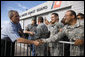 President George W. Bush shakes hands of military personnel outside the emergency operations center at the U.S. Coast Guard Hangar at Ellington Field in Houston Tuesday, Sept. 16, 2008, during his visit to Texas to see firsthand the destruction left in the wake of last weekend's Hurricane Ike. White House photo by Eric Draper