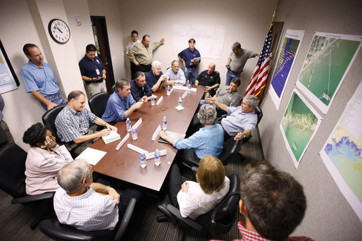 President George W. Bush speaks with state and local officials during a briefing Tuesday, Sept. 16, 2008, at the Galveston emergency operations center. The President spent the day in Texas visiting the areas hardest hit by Hurricane Ike, which made landfall September 13 near Galveston as a Category 2 storm with sustained winds of 110 miles per hour. White House photo by Eric Draper