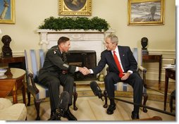 President George W. Bush and U.S. Army General David Petraeus, former Commander of the Multi-National Force in Iraq, shakehands Wednesday, Sept. 17, 2008, in the Oval Office at the White House. In speaking to reporters President Bush honored and congratulated General Petraeus for his outstanding command leadership in Iraq, and thanked him for agreeing to be the new commander of CENTCOM. White House photo by Eric Draper