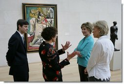 Mrs. Laura Bush stops in front of Pablo Picasso's painting 'Nude Man and Woman' as she is given a tour of the Nasher Sculpture Center by Acting Chief Curator Jed Morse, left, Trustee Nancy Nasher, gesturing, and Debbie Francis, right, Friday, Sept. 19, 2008 , in Dallas, Texas. White House photo by Chris Greenberg