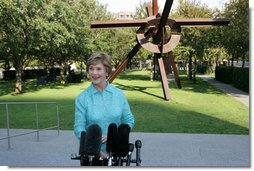 Mrs. Laura Bush addresses the media in the garden of the Nasher Sculpture Center at the conclusion of her tour of the new exhibit, Friday, Sept.19, 2008, in Dallas. Mrs. Bush said that the exhibit, which opened a few hours later, is in many ways about the relationships that Ray and Patsy Nasher had with the greatest artists of their generation - Picasso, Rodin, Oldenburg, Matisse and many others. The works had been in the Nasher home and are now at the center for enjoyment by the public.  White House photo by Chris Greenberg