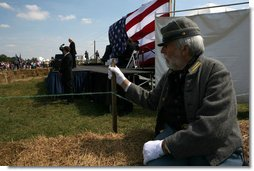 Vice President Dick Cheney delivers remarks during the cemmoration of the 145th anniversary of the Battle of Chickamauga in McLemore's Cove, Georgia. as a Confederate participant looks on. White House photo by David Bohrer