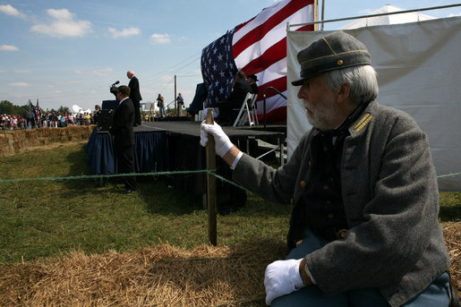 Vice President Dick Cheney delivers remarks during the commemoration of the 145th anniversary of the Battle of Chickamauga in McLemore's Cove, Georgia. as a Confederate re-enactment participant looks on. White House photo by David Bohrer