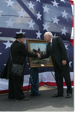 Re-enactment participant Jack Fishman presents Vice President Dick Cheney with an oil painting on September 19, 2008, depicting Cheney's great-grandfather Samuel Fletcher Cheney at the Battle of Chickamauga. Cheney's great-grandfather fought in the 1863 Civil War battle as Captain in the 21st Ohio Volunteer Infantry. White House photo by David Bohrer