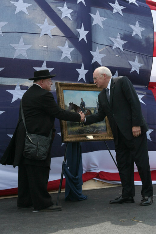 Re-enactment participant Jack Fishman presents Vice President Dick Cheney with an oil painting on September 19, 2008, depicting Cheney's great-grandfather Samuel Fletcher Cheney at the Battle of Chickamauga. Cheney's great-grandfather fought in the 1863 Civil War battle as a Captain in the 21st Ohio Volunteer Infantry. White House photo by David Bohrer