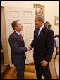 President George W. Bush welcomes Colombian President Alvaro Uribe into the Oval Office Saturday, Sept. 20, 2008, at the White House. White House photo by Eric Draper