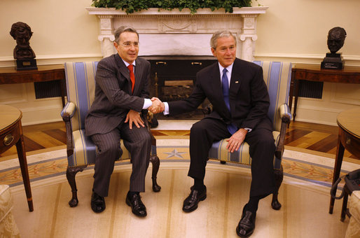 President George W. Bush shakes hands with Colombian President Alvaro Uribe following a meeting Saturday, Sept. 20, 2008, in the Oval Office of the White House. White House photo by Eric Draper