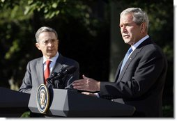 President George W. Bush gestures as he delivers his remarks during a joint press availability with Colombian President Alvaro Uribe Saturday, Sept. 20, 2008, in the Rose Garden at the White House. White House photo by Eric Draper