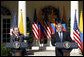 President George W. Bush listens as Colombian President Alvaro Uribe speaks to a reporter Saturday, Sept. 20, 2008, during a joint press availability in the Rose Garden at the White House. White House photo by Eric Draper